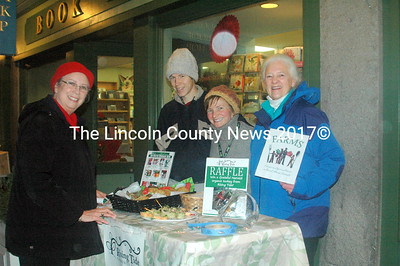 Toni Crouch (left) stopped by the Rising Tide and FARMS tables on Thursday. Rising Tide offered wraps and treats free of charge for shoppers. Rising Tide employees Peter Kraus and FARMS member Ann Baldwin were happy to share information and treats with shoppers. (Eleanor Cade Busby photo)