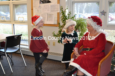 Dante George (left) and Kylee Smith chat with Mrs. Claus during breakfast with Santa at the Wiscasset Senior Center, Saturday, Dec. 19. (Charlotte Boynton photo)