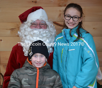 Zachary Hansell and Jessica Hendsbee visit Santa Claus during the Wiscasset, Waterville & Farmington Railway Museum's annual Victorian Christmas celebration Saturday, Dec. 19. (Abigail Adams photo)