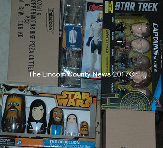 "In addition to items like Christmas ornaments and socks, Smitten Collectibles & Nerdy Treasures also stocks special-edition collector's items, such as ""Star Trek"" bobbleheads and ""Star Wars"" nesting dolls. Chalmers said the store tends to sell out of these items before and after major comic book conventions. (Maia Zewert photo)"