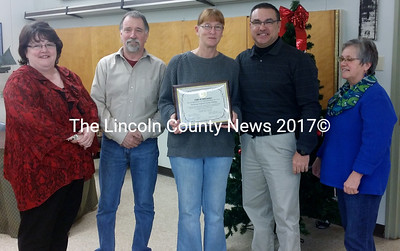 Wiscasset Police Department Sgt. Kathy Williams displays a certificate of appreciation from town officials during her retirement party Dec. 23.   From left: Town Manager Marian Anderson, Selectman Ben Rines Jr., Williams, Police Chief Troy Cline, and Selectman Judy Flanagan. (Photo courtesy Wiscasset town office)