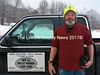 Newcastle resident Steve Gracie stands next to his pickup truck in Newcastle Monday, Jan. 12. The case in his hand contains chemotherapy drugs. Gracie has terminal cancer, but wants to use the time he has to help other patients. (J.W. Oliver photo)