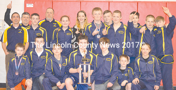2015 Pine Tree Wrestling League champions, the Medomak Middle School Riverhawks. Team members are (front, from left) Marshall Sawyer, Eli McCollett, Duncan Widdecombe, Eli Miller, Will Perry, Brady Carter, and Taylah Reed. Back row: assistant coach Kurt McCollett, assistant coach Fritz Milles, Korbin Daniels, coach Eric Hunt, Savanah Gilbert, Olivia Jenkins, Erik Benner, Ashton Daniels, Amos Hinkley, Jake Gess, Dylan O'Reilly, and Shane Cookson. (Carrie Reynolds photo)