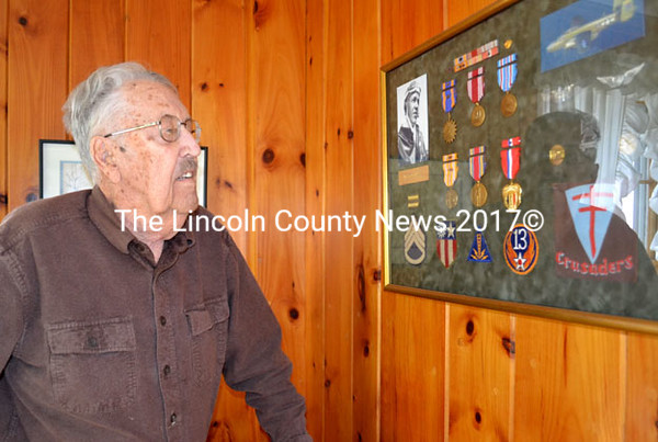 World War II veteran George Jones points out the medals, and ribbons he received during his three year tour of duty in the U.S. Army Air Force, now   framed and hanging on the wall of his Wiscasset home. (Charlotte Boynton photo)