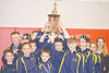 The Medomak Middle School Riverhawks raise their trophy after winning the Pine Tree Wrestling League state championship on Saturday. (Carrie Reynolds photo)