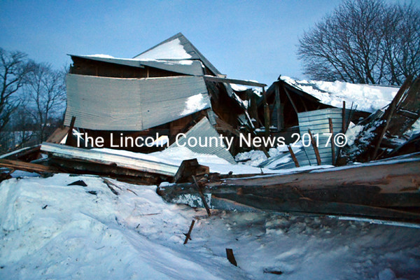 The Happy Farm barn in Whitefield lies in ruins Tuesday, Feb. 24. The iconic barn collapsed on Sunday due to the weight of snow, owner Robin Chase   said. (Abigail Adams photo)
