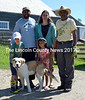 Pumpkin Vine Family Farm's workforce poses for a photo. Back from left: Anil Roopchand, Kelly Payson-Roopchand, and Anil's father, Roopchan Rambharose. Front from left: Anil and Kelly's children, Keiran and Sarita, and the family dog, Donegal. (D. Lobkowicz photo)