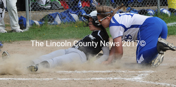 Morgan Achorn scores on a passed ball and collides with Morse catcher Marissa Parks. (Paula Roberts photo)