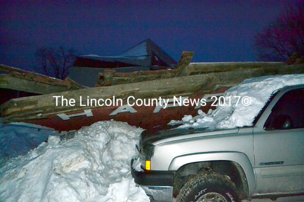 The collapsed Happy Farm barn in Whitefield on Tuesday, Feb. 24. The barn was a roadside attraction on Route 126. (Abigail Adams photo)