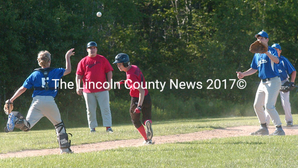 Wiscasset's Jake Traylor is caught in a pickle between third and home by Union Farm players Chris Bowman and Nathan Emerson. (Carrie Reynolds photo)