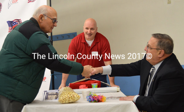 George Green warmly greets Maine Gov. Paul LePage prior to the governor's address to the Lincoln County Republican Committee in Waldoboro Feb. 18. Lincoln County Republican Committee Chair Stuart Smith looks on. (Sherwood Olin photo)