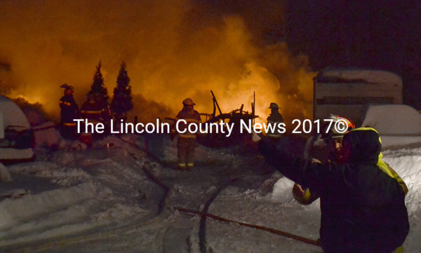 Firefighters battle a structure fire on Mills Road in Whitefield Tuesday, Jan. 27. The single-family home was fully engulfed in flames when   firefighters arrived, according to Whitefield Fire Chief Scott Higgins. (D. Lobkowicz photo)