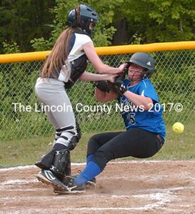 Bristol's Jayden Gilbert scores on a collision with Medomak catcher Kayla Donlin. (Carrie Reynolds photo)