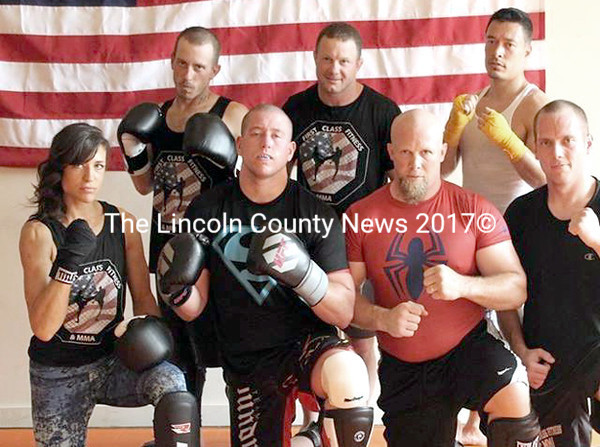 Newcastle resident Hannah Sparrell poses with other fighters from First Class Fitness & MMA in Brunswick. Sparrell will make her MMA debut during New England Fights XIX at the Androscoggin Bank Colisee in Lewiston Saturday, Sept. 12. (Photo courtesy Hannah Sparrell)