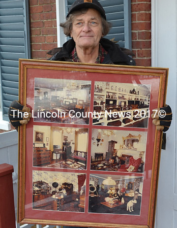 Douglas Henderson holds framed photographs of the Musical Wonder House Dec. 8. When Henderson left the museum in 1986, the collection he helped build was valued at approximately $3 million. He received nothing from its recent liquidation. (Abigail Adams photo)