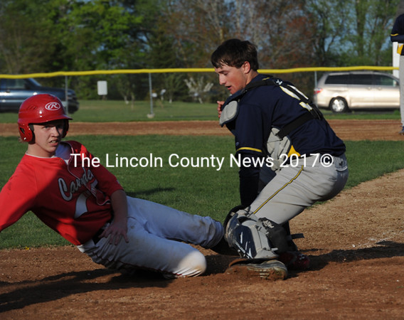 Medomak Valley catcher Patrick Madden tags out Camden's Ryan Pierce in the top of the seventh to prevent the tying run. (Paula Roberts photo)