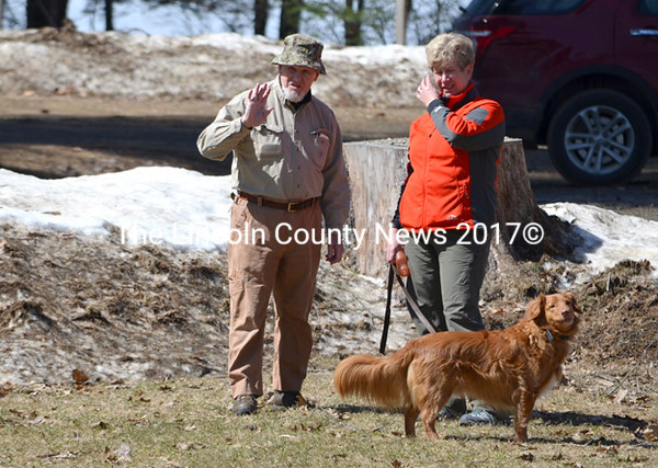 Scent specialist Tom Osterkamp talks with Maine Search and Rescue Dogs team Sarah Robinson and Zeke. (Photo courtesy Leslie Howe)