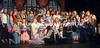 """Susan and Dean Domeyer sit front and center surrounded by many performers from the 10 years they operated The Boothbay Playhouse. The group opened their farewell reunion with the theater world's unofficial theme song, """"There's No Business Like Show Business."""" (Eleanor Cade Busby photo)"""