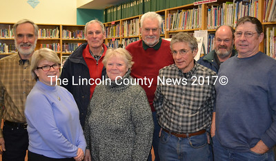 Whitefield's Coopers Mills Dam Committee held a public hearing to discuss their decision to recommend dam removal at the Whitefield Elementary School Jan. 21. Back row from left, Chuck Vaughn, Louis Sell, Herb Hartmann, and Scott Higgins. Front row from left, Leslie McCormick, Jane Chase, Tony Marple, and Barry Tibbetts. (Abigail Adams photo)