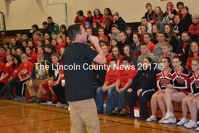 WGME News 13's anchor Jeff Peterson addresses packed bleachers at the start of Wiscasset Middle High School's school spirit pep rally shortly after 6 a.m. Jan. 22. (Abigail Adams photo)