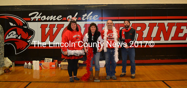 From left, Wiscasset All-Sports Boosters Karen Potter, Carol James, and Gordon Campbell, and Wiscasset Parks and Recreation Director Todd Souza stand in front of a new wall mat the boosters purchased for the Wiscasset Middle High School gym on Friday, Jan. 22.