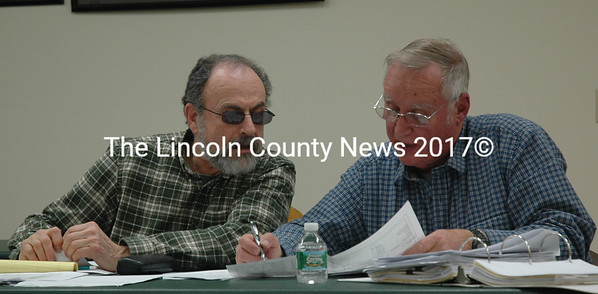 Bristol Budget Committee members John Freeman (left) and Chuck Hanson review the Bristol Fire and Rescue budget during a meeting at the New Harbor Fire Station on Thursday, Feb. 11. (Maia Zewert photo)