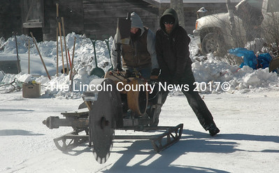 Ken Lincoln, the president of the Thompson Ice House Preservation Corporation, and his son Kyle Lincoln operate the ice saw during the annual ice harvest held on Valentine's Day. Volunteers of all ages had the opportunity to use antique ice-cutting tools to harvest blocks of ice from Thompson Pond during the annual event. (Maia Zewert photo)