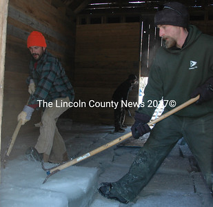 Jon Kelsey and Kyle Lincoln move a block of ice into place during the annual ice harvest at the Thompson Ice House in South Bristol Sunday, Feb. 14. (Maia Zewert photo)