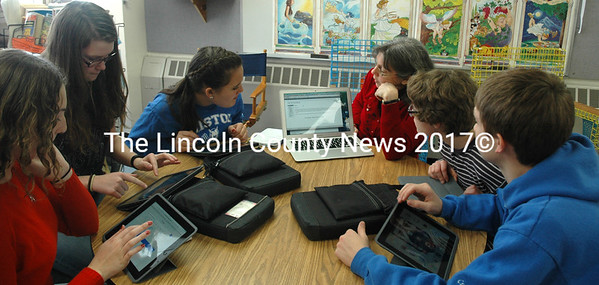 Members of The Bristol Buzz news team meet during study hall Friday, Feb. 12 to discuss possible articles for the upcoming week with Bristol Consolidated School language arts teacher Becky Cooper. From left, Erika Mathieson, Brooke Seiders, Emily Kelsey, Cooper, Addie Mullin, and Chase Crockett. (Maia Zewert photo)
