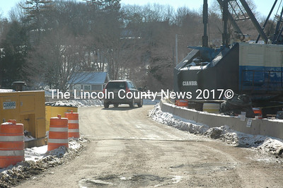 A vehicle crosses the temporary bridge as construction continues on the new drawbridge in South Bristol on Friday, Feb. 12. (Maia Zewert photo)