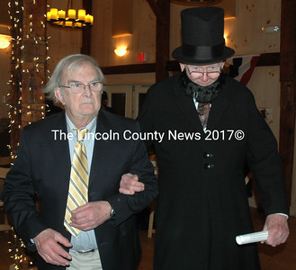 Lincoln County Republican Committee Secretary Ken Maguire escorts an Abraham Lincoln re-enactor back to his seat during the Lincoln Day dinner at The 1812 Farm in Bristol Mills Friday, Feb. 12. The event celebrated Lincoln's 207th birthday and featured Civil War re-enactors, a meal of some of Lincoln's favorite foods, and music of the Civil War. (Maia Zewert photo)