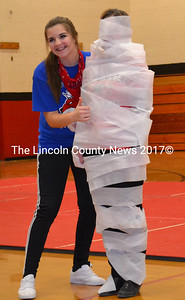 Sophomore Lindsey Gordon is all smiles after mummifying Deb Pooler in toilet paper during the final assembly of the 2016 Winter Carnival, Feb. 12. (Charlotte Boynton photo)