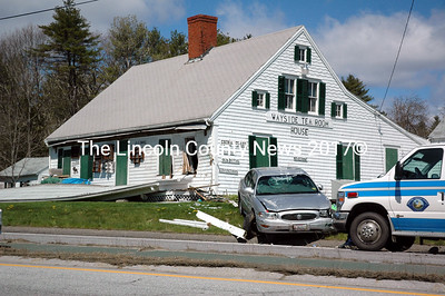 Debris lines the road after a Buick sedan struck the Wayside Tea Room House on Route 1 in Nobleboro on Monday, May 9. (Alexander Violo photo)