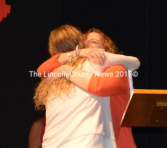 CLC YMCA Program Coordinator Karen-Ann Hagar (right) hugs Brie Wajer during the Y's annual meeting Tuesday, May 10. Wajer was awarded the Youth Development Award during the meeting. (Maia Zewert photo)