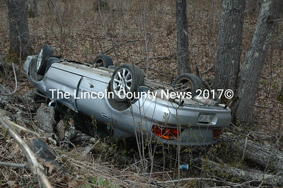 An Acura sedan lies on its roof after a single-vehicle accident on Route 32 in Waldoboro on Sunday, May 8. (Alexander Violo photo)