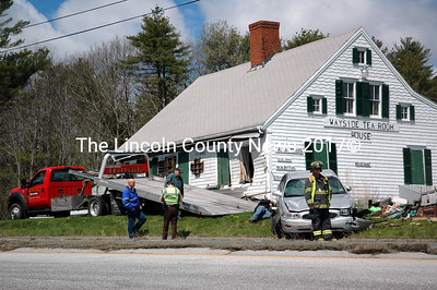 A tow truck prepares to remove a Buick sedan from the front yard of the Wayside Tea Room House on Route 1 in Nobleboro the morning of Monday, May 9. The car struck the front of the building and its driver was taken to the hospital. (Alexander Violo photo)