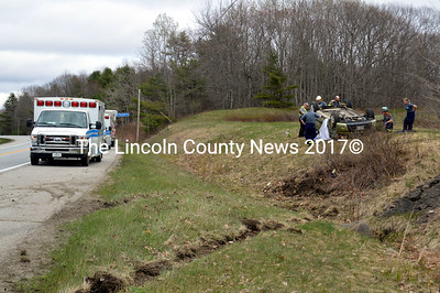Emergency services respond to a fatal single-vehicle rollover on Route 1 in Damariscotta north of the Damariscotta-Newcastle bridge the afternoon of Wednesday, May 4. (Maia Zewert photo)