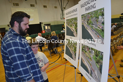Kurtis Bragan and his son Wesley look at Maine Department of Transportation renderings of proposals to reduce traffic congestion downtown during an open house at the Wiscasset Community Center on Tuesday, May 10. (Abigail Adams photo)