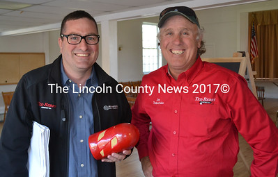 "From left: Matt and Jim Timberlake, of the Ted Berry Co., stand with a ""pig"" following the Edgecomb Board of Selectmen's Monday, May 9 meeting. The ""pig"" will be used to clean Edgecomb's sewer line. (Abigail Adams photo)"
