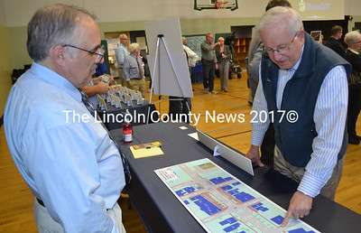 Wiscasset resident Tony Belmont (right) looks at renderings of downtown Wiscasset with Ed Hanscom, the Maine Department of Transportation's head of transportation analysis, at the Wiscasset Community Center on Tuesday, May 10. (Abigail Adams photo)