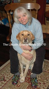 Cat Crozier and Farley in Crozier's Pemaquid home Monday, Jan. 18. Crozier is seeking volunteers to assist in an effort to create a dog park in Bristol. (Maia Zewert photo)
