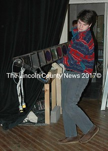 Lincoln Academy senior Liam Dworkin hauls a light fixture out of a closet at the Lincoln Theater in Damariscotta Monday, Jan. 18. Dworkin, along with other members of Lincoln Academy's service fraternity, Alpha Sigma Gamma, spent Martin Luther King Jr. Day performing various acts of community service around the county. (Maia Zewert photo)
