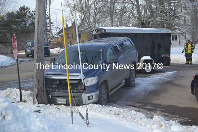 A Toyota pickup truck struck a Central Maine Power Co. utility pole after colliding with a Dodge Sedan in Waldoboro Friday morning, Jan. 15. (Alexander Violo photo)
