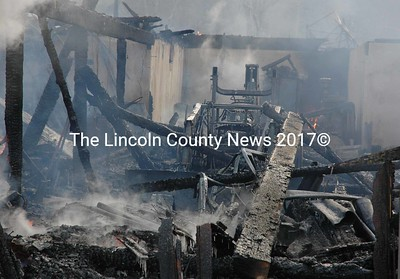 Lumber and woodworking equipment were lost in a fire that destroyed a two-story barn in South Bristol early Thursday morning, Jan. 14. The barn was the workshop of Steve Viega, owner of Steve Viega Woodworking. (Maia Zewert photo)