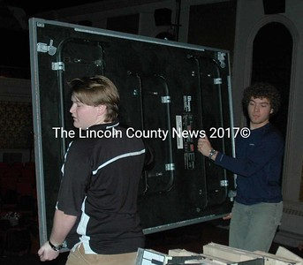 Lincoln Academy students Liam Brinkler (left) and Abe Steinberger move a riser in the Lincoln Theater in Damariscotta on Martin Luther King Jr. Day, Monday, Jan. 18. Brinkler and Steinberger are members of Sigma Alpha Gamma, Lincoln Academy's service fraternity, which commemorates the holiday every year by doing community service around the county. (Maia Zewert photo)