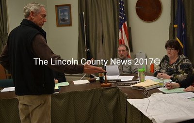 Developer Donald Felvey addresses the Wiscasset Board of Selectmen on Jan. 19 to ask for an end to his lease with the airport. Felvey also requested a stipulation be added to a future lease with another developer that would allow him to recoup 75 percent of the cost of developing the land for the construction of hangars. (Abigail Adams photo)