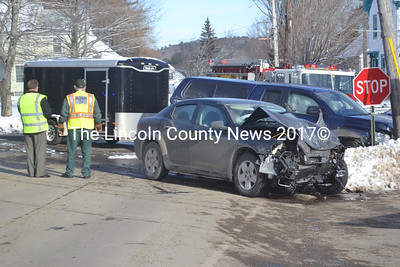 A pickup truck with a trailer and a sedan collided shortly at the corner of Bremen Road and Main Street in Waldoboro shortly after 10 a.m., Friday, Jan. 15. (Alexander Violo photo)