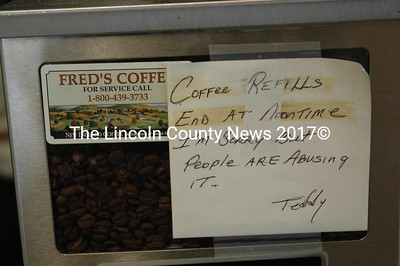 A note written by Teddy Dee still resides over a coffee maker at Dee's Variety in Pemaquid Jan. 19. Dee's wife Patti said Teddy Dee loved running the store, but loved the people who worked there more. (Maia Zewert photo)