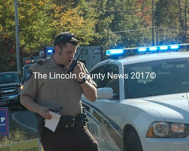 Detective Jared Mitkus, of the Lincoln County Sheriff's Office, responds to the scene of a motorcycle accident on Route 32 in Bremen on Friday, Oct. 7. (Alexander Violo photo)