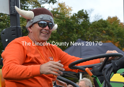 Damariscotta Pumpkinfest co-founder Buzz Pinkham waves during the annual Giant Pumpkin Parade on Saturday, Oct. 8. (Maia Zewert photo)